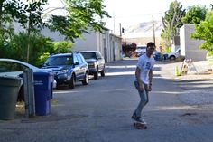 Members of Cayucas trying out their new Goldcoast longboard outside of Kilby Court.