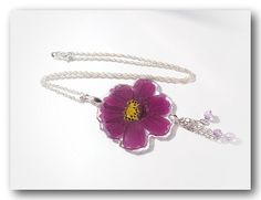 The pendant measures :  5 cm W * 4.5 cm H with 925 18 inch Sterling silver chain with a lobster clasp.