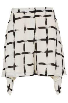 Silk cross print shorts by Unique