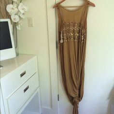 NWT Free People Bali Slit Dress - S Price FIRM. Gorgeous mustard color. Beyond chic. Leg slits on both sides. Stunning beadwork. Size says Small but this is more like one size fits all to be honest. The other one I have is a Large and I didn't notice a difference in how they fit. No trades please, thx!  Free People Dresses