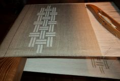 Mette Frøkjær: placemats - looks like damask or turned twill, but could easily be done in S&W