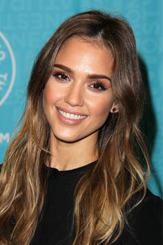A sexy nude gloss with flecks of golden shimmer is the perfect finishing touch to Jessica Albas monochromatic makeup look.