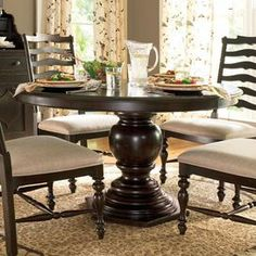 "Weathered pedestal dining table with a hexagon-shaped base.   Product: Dining tableConstruction Material: WoodColor: TobaccoFeatures: Part of the Paula Deen Home Collection Hexagon-shaped baseIncludes one 18"" leaf Dimensions: Without Leaf: 30"" H x 54"" DiameterWith Leaf: 30"" H x 72"" W x 54"" D  Note: Chairs not included"