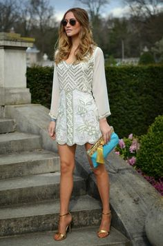 Nice dress for a wedding. Sparklin short dress with long sleeves.
