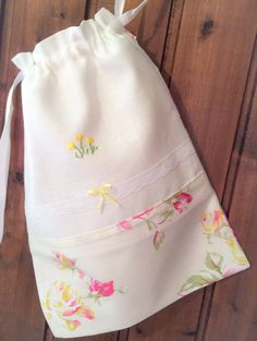 Travel Lingerie Bag, Linen Drawstring shoe bag with hand embroidered yellow flowers and satin bow. Great travel accessory also makes a lovely gift