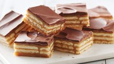 These easy caramel and chocolate layered cracker toffee bars are a twist on a traditional cracker toffee Triple-Layer Cracker Toffee Bars 90 buttery rectangular crackers ((from 13.7-oz box))1 can ((14 oz) sweetened condensed milk (not evaporated))1 cup packed brown sugar1/2 cup butter1/4 cup milk1 bag ((11.5 oz) milk