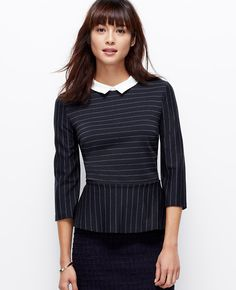 Topped with a woven point collar, our striped peplum top subtly cinches at the waist to highlight curves in a way that's bold and demure all at once. Jewel neck with woven point collar. 3/4 sleeves. Exposed back zipper.