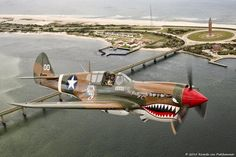 The American Airpower Museum Warhawk over the Captree Bridge and the west end of Fire Island today during practice flights for the Weekends Air Show and Museum Flight Operations Ww2 Aircraft, Fighter Aircraft, Military Aircraft, Fighter Jets, Fixed Wing Aircraft, Airplane Art, Ww2 Planes, Vintage Airplanes, Nose Art
