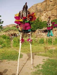 These are Moko Jumbies, (stilt walkers). They are thought to originate from a West African tradition brought to the Caribbean. My mom is West Indian, (she's from the US Virgin Islands) and I can remember her talking about them whenever she spoke of the Caribbean festivals.