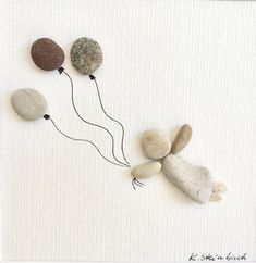 The flying girl hovers through the air with balloons that symbolize desires: love, happiness, health. A loving gift for a beloved person. These stones come from the beaches of the Mediterranean Sea and are applied on high-quality watercolor paper. Something very special. The frame