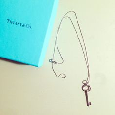 Tiffany & Co. Oval Key Charm Classic Necklace Authentic Tiffany & Co. key - only worn a handful of times.  The chain is sterling silver but is not Tiffany's. Comes with box but no pouch. Tiffany & Co. Jewelry Necklaces