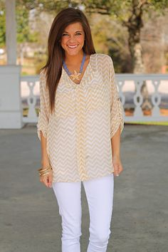 "This is a top that you can dress up or down! Add white skinnies for a casual look or tuck it into a skirt for the office:) Either way this one is a fashion faithful. Thanks to the lightweight material, it will keep you cool on those hot Summer days!   Fits true to size. Miranda is wearing the small.   From shoulder to hem:  Small - 28.5""  Medium - 29""  Large - 29.5"""