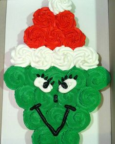 Grinch cupcakes  This is so funky and awesome!  Draw the eyes nose mouth on at the very end.  #grinch #cake #indulgent #yum #delish #yummy #art #crafty #festive #diy #DIY #christmasdecoration #foodporn #christmas #xmas #cupcake
