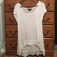 High to low shirt!  White low to high top. Very flowy and fun to wear! One worn once or twice.  living doll Tops Tees - Short Sleeve