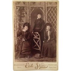 Three young ladies had their photograph made in Tipton, Iowa. These Victorian Era ladies are properly dressed for an outing complete   with umbrellas.