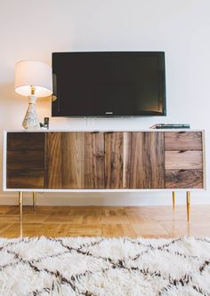 mid century style TV CONSOLE designed by homepolish company.