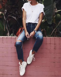 White t-shirt, distressed jeans, white sneakers