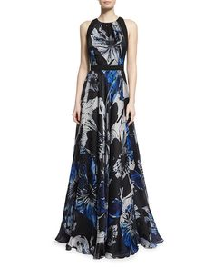 Hawaiian Frock: Need something for a Hawaiian wedding? This delightful blue and black floral-patterned mother of the bride dress can easily go from beach ceremony to hotel reception. Wear with wedge sandals rather than traditional heels to avoid tripping in the sand.