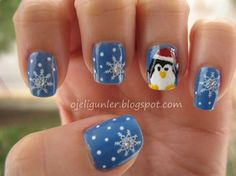 Hand painted penguin and slowflakes - Nail Art Gallery by NAILS Magazine