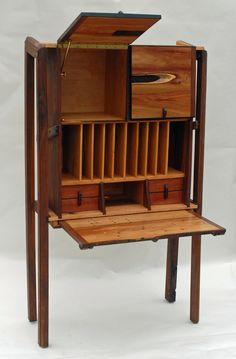 Secretary desk adapted for concept of using it with netbooks, ultrabooks, laptops or tablets. 1,250. via Etsy.