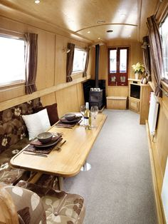 The Peacock has the saloon at the bow. Here an L shaped dinette is fitted to provide seating and dining space - this converts to a double berth for guests.