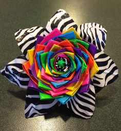 A duct tape flower - great idea for my FCCLA club to use in the recycle/redesign category