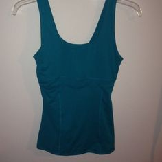 Teal workout top w/ built in bra Size s workout top never worn too small for me Champion Tops Camisoles