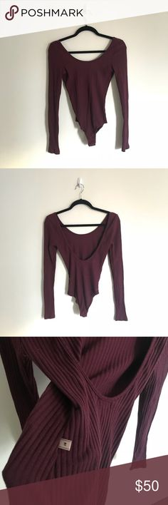 •NYTT• Wide Ribbed Bodysuit In Maroon ❣️'With a focus on the versatility of knitwear, NYTT gives a sophisticated spin to your basic tee. Capturing the fundamentals of modern minimalism, NYTT's unique knitwear pieces will redefine and elevate your closet.'❣️ •Material: 50% cotton, 46% polyester, 4% spandex. •Care: Hand wash cold. •Fabric: Ribbed knit fabric. •Condition: GUC, no visible flaws •Price Firm-not in a rush to sell. NYTT Tops Tees - Long Sleeve
