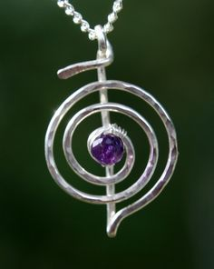 Reiki Pendant She's into natural healing and such, as well this also reminds me of a treble clef for her music interest.