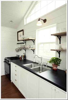 Faux soapstone countertop, high quality plywood covered with chalkboard paint and paste wax.