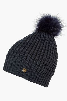 Helly Hansen has designed a cozy, fleece lined knit pom beanie to stay warm all winter long. Fits ages 10-Adult