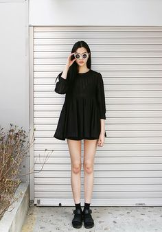 Shop+this+look+on+Lookastic:  http://lookastic.com/women/looks/casual-dress-and-socks-and-shorts-and-sunglasses-and-flat-sandals/2967  —+Black+Pleated+Casual+Dress+ —+Black+Socks+ —+Black+Shorts+ —+Black+and+White+Sunglasses+ —+Black+Leather+Flat+Sandals+