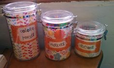 Organization tip: Store your writing center materials in clear kitchen canisters! Line them with scrapbook paper to match yor classroom!