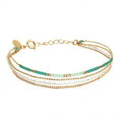 Ce+bracelet+se+compose+de+quatre+chaînes+fines+agrémentées+de+perles+de+Miyuki bordeaux, vert+d'eau,+menthe+et+or.Trois+des+chaînes+sont+dorées+à+l'or+fin,+la+quatième+est+en+argent+925°°…
