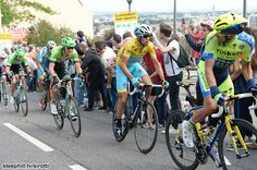 2014 tour-de-france photos stage-07 - Alberto Contador looks around to see the race leader easily positioned on his back wheel