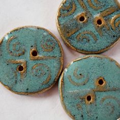 Buttons handmade ceramic. $8.00, via Etsy.
