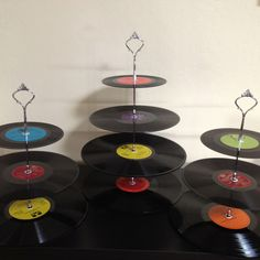 Vinyl cupcake stand complete, DIY instructions found at   http://www.bubbyandbean.com/2011/12/diy-tutorial-vintage-vinyl-record.html