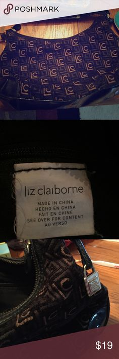 Liz Claiborne small bag Liz Claiborne small fabric heavy black felt like bag with the LC logo on the outside this is a cloth bag inside has some compartments in the zipper compartment and it zips closed has a Sheehan shiny plastic strap is a bit scratched not sure if it's whether or not it's a little bit one on the strap otherwise the bags in excellent condition thanks for browsing if interested make offers Liz Claiborne Bags Mini Bags