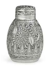 A SILVER TEA CADDY MARK OF DOMINICK & HAFF, NEW YORK, 1881, RETAILED BY THEODORE B. STARR Ovoid, with chased spiraling fern decoration, marked under base, also marked 28 5 in. (12.7 cm.) high; 8 oz. (250 gr.)