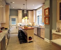 Vrabel traditional kitchen  Our kitchens can get so busy and hectic with kids doing homework, guests hanging out and, of course, everyone preparing meals. A bluish-green paint color with gray undertones can help maintain calm.Suggested paint pick: Woodland Green, Benjamin Moore