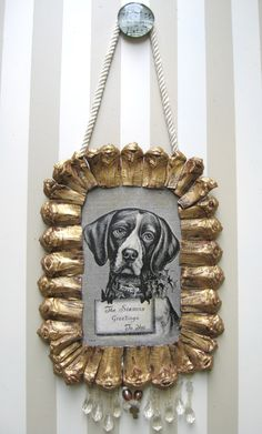 gold pine cone frame. So awesomely weird