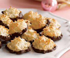 These low-fat, low-calorie coconut macaroons are dipped in melted chocolate for a yummy holiday treat.