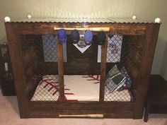 Baseball dugout bed that Easton's daddy made for him. Thanks to Cristen at GAandtheBear for the awesome baseball quilt!!!