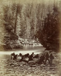 """""""Portaging canoes at Upper Gate of Murchison's Rapids"""". This photo by Benjamin Baltzly was taken on the North Thompson River during the Geological Survey of Canada in 1871."""