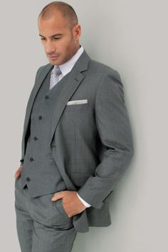 Light Grey three piece suit looks stunning in an outdoor setting.