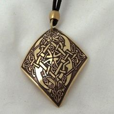 """Irish handcrafted etched brass Celtic pendant.  Celtic knotwork entwined with mythical Celtic beasts highlights the Pictish Art reproduced on this handcrafted Celtic necklace.  Most likely to be Celtic hounds.  In Celtic myth tales hounds are symbols of extreme loyalty, honour  and courage. The name of the God Cuchulain is literally """" Hound of Culann.""""  The hound is also a wonderful symbol for Healing.  A Celtic gift from Beara, West Cork, Ireland.  Handcrafted by Aqua Fortress. Celtic Necklace, West Cork, Space Wolves, Cork Ireland, Iron Age, Loyalty, Irish, Highlights, Aqua"""