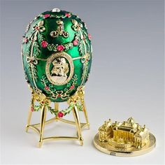 Alexander Palace Faberge Egg. Material: Pewter, Crystals,.Dimensions (without Stand): 4.5in (H) x 2.2in (D). The famed Faberge eggs are jeweled eggs, often with the most ornate, minuscule designs on them. The House of Faberge made the original pieces from 1885 to 1917.