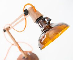 DeGross Design & Innovation Terralux This beautiful Task angle poise lamp is made from up-cycled umber glass bottles and Sapele wood. Old Bottles, Glass Bottles, Glass Jug, Recycled Bottles, Lighting Concepts, Lighting Design, Industrial Lighting, Cool Lighting, Design Innovation