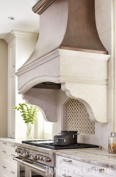 Our Morrocan Mosaic in Suede shown as a feature above the stove | Traditional Home