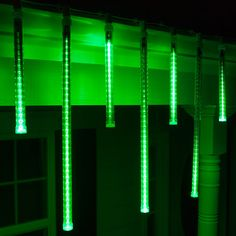 Vivid green cascade LED light tubes look like stars shooting down from the roof or and create a mesmerizing meteor shower hanging from tree branches! Cascade Lights, Icicle Lights, Led Christmas Lights, Hanging Lights, Christmas Decorations, Led Replacement Bulbs, Green Led, Green Lights, Dimmable Light Bulbs